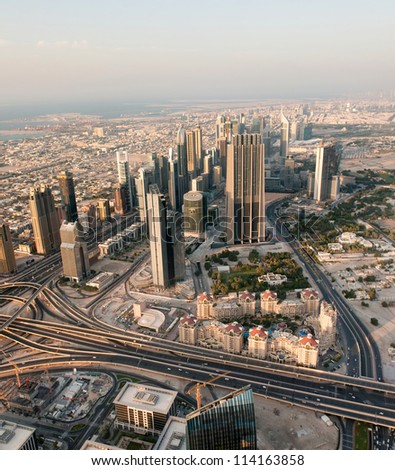 Downtown Dubai modern city. View from the lookout Burj Khalifa. Dubai is the most expensive city in the Middle East. United Arab Emirates - stock photo