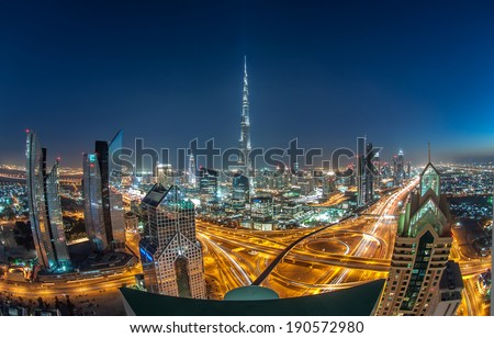 DOWNTOWN DUBAI, UAE - Feb 11: Burj Khalifa, the tallest skyscraper in the world standing at 829.8m in Dubai on Feb 11,2014. Shot taken on a Busy evening in Sheik Zayed Road in Downtown Dubai. - stock photo