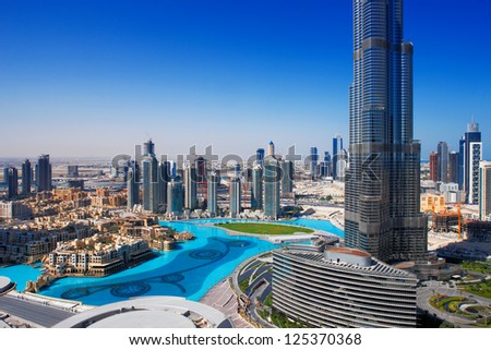 DOWNTOWN DUBAI, UAE - MAY 7 - The Dubai Fountain is set on the 30-acre manmade Burj Khalifa Lake. Lit by 6600 lights and 50 projectors it shoots water 150 m into the air. Picture taken on May 7, 2010. - stock photo