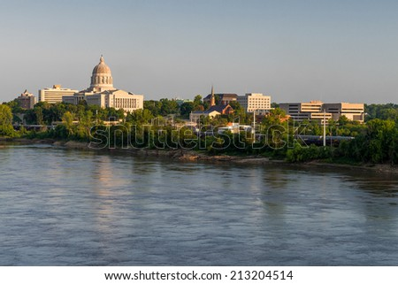 Downtown Jefferson City from across the Missouri River in Jefferson City, Missouri  - stock photo