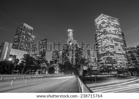 Downtown Los Angeles skyline during rush hour at sunset black and white  - stock photo