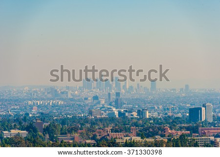 Downtown Los Angeles skyline over blue cloudy sky