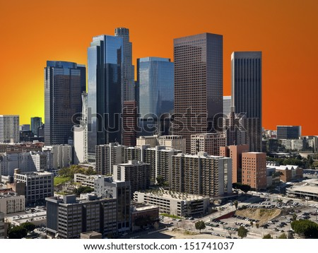 Downtown Los Angeles with orange sunset sky.