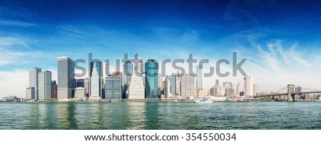 Downtown Manhattan over East river. - stock photo