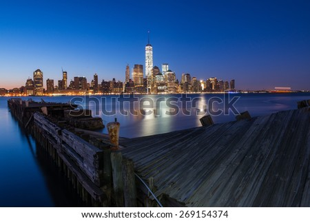 Downtown Manhattan Skyline at Dusk as seen from Jersey City - stock photo
