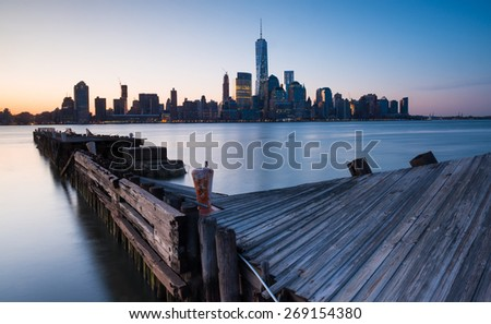 Downtown Manhattan Skyline at sunrise as seen from Jersey City - stock photo