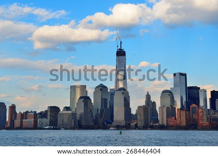 Downtown Manhattan skyline at sunset over Hudson River in New York City - stock photo