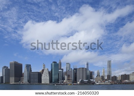 Downtown Manhatten New York cityscape with cloudscape.