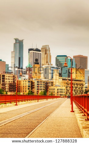 Downtown Minneapolis, Minnesota in the evening as seen from the famous stone arch bridge - stock photo