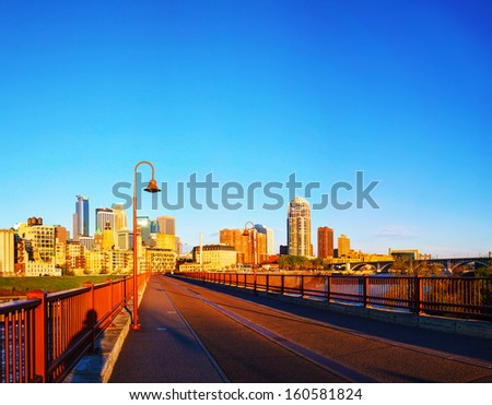 Downtown Minneapolis, Minnesota in the morning as seen from the famous stone arch bridge - stock photo