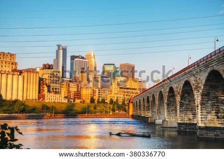 Downtown Minneapolis, Minnesota in the morning with famous Stone Arch bridge - stock photo