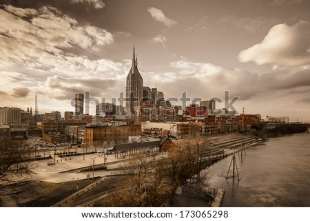 Downtown Nashville, TN with view of the river from the walking bridge - stock photo