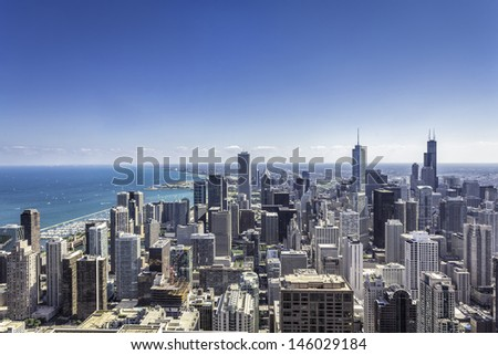 Downtown of Chicago aerial view against blue sky - stock photo
