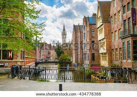 Downtown of Ghent with canal, clock tower, medieval buildings, Belgium - stock photo