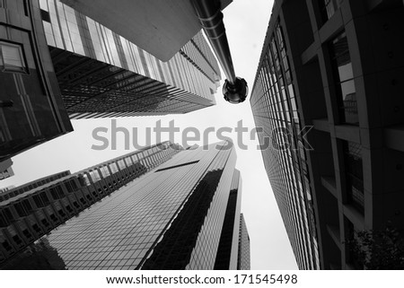 Downtown Philadelphia with a perspective in the middle of the street staring into the sky - stock photo