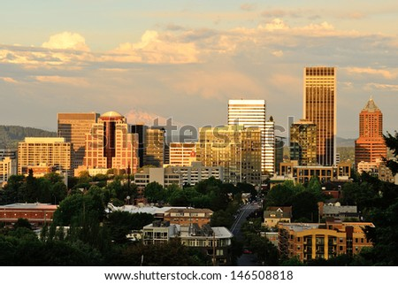 Downtown Portland Oregon from the Vista Bridge at sunset with a thunderstorm in the background - stock photo