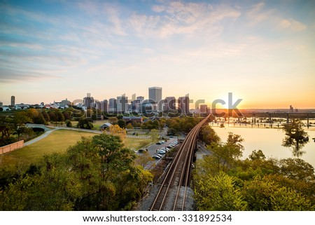 Downtown Richmond, Virginia skyline and the James River at twilight. - stock photo