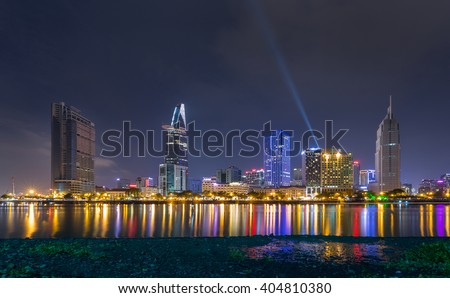Downtown Saigon, Ho Chi Minh city by night - the biggest city in Vietnam. - stock photo