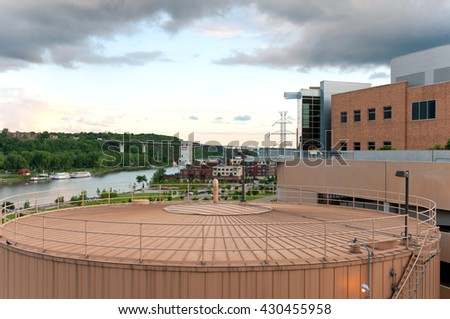 downtown saint paul overlooking mississippi river and city landmarks including storage tank for district energy system - stock photo