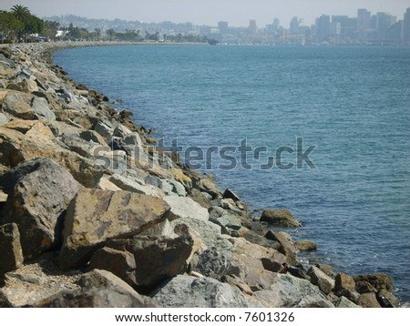 Downtown San Diego view at the end of the rocky coastline from Harbor Island. - stock photo