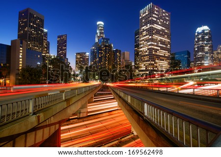 Downtown skylines lit up at night, Los Angeles, California, USA - stock photo