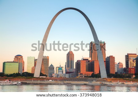 Downtown St Louis, MO with the Old Courthouse and the Gateway Arch at sunrise - stock photo