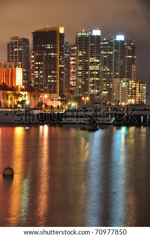 Downtown towers reflect in the water of San Diego Bay. - stock photo