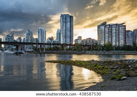 Downtown Vancouver and Cambie Bridge During a Cloudy Sunset. Picture taken at Habitat Island. - stock photo
