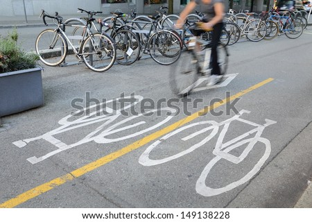 Downtown Vancouver Cycle Path. Dedicated bicycle lane separated from vehicle traffic in downtown Vancouver, British Columbia, Canada. Bicycle parking in the background.  - stock photo