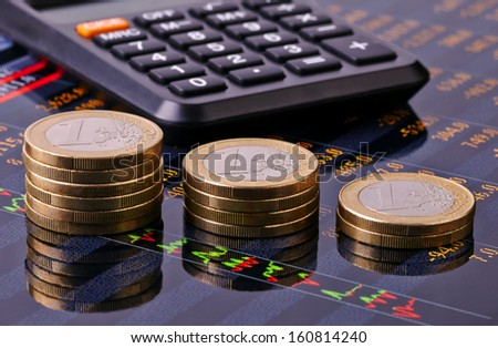 Downtrend  stacks of euro coins, calculator and financial chart as background. Selective focus - stock photo