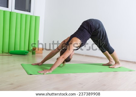 Downward facing dog, yoga pose - stock photo