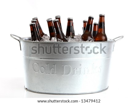 Dozen beers in a silver bucket - stock photo