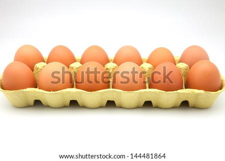 dozen eggs in cardboard box - stock photo