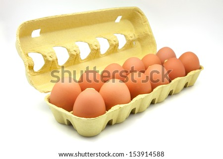 dozen of eggs in carton - stock photo