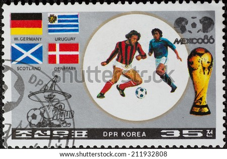 DPR KOREA - CIRCA 1986: a stamp printed by DPR KOREA shows football players and Soccer Pique. 1986 FIFA World Cup football in Mexico, series, circa 1986 - stock photo