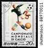 DPR KOREA - CIRCA 1988: a stamp printed by DPR KOREA shows football players. World football cup in Italy, series, circa 1988 - stock photo