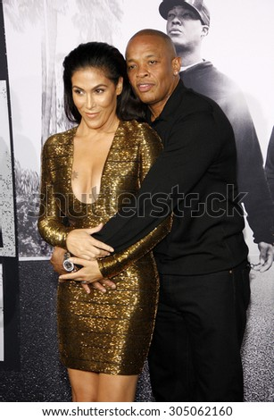 Dr. Dre and Nicole Young at the Los Angeles premiere of 'Straight Outta Compton' held at the Microsoft Theatre in Los Angeles, USA on August 10, 2015.  - stock photo