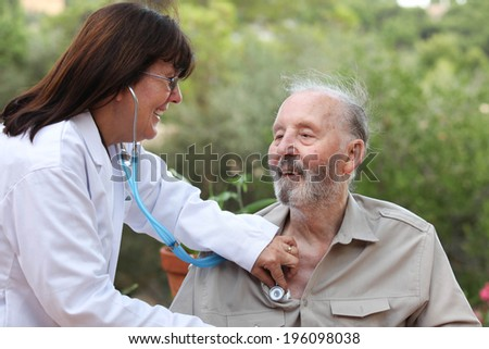 dr with stethoscope checking senior patients heat beat - stock photo