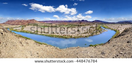 Draa river scenery in marrakesh.Atlas mountain in morocco.Water and desert landscape.Panorama Draa river scenical. - stock photo