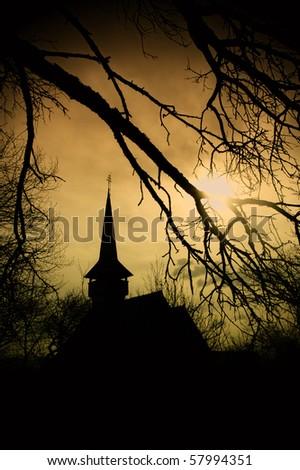 Dracula's land at sunset, church in Transylvania - stock photo