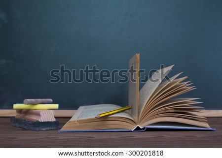 draft, books and chalk to blackboard background - stock photo