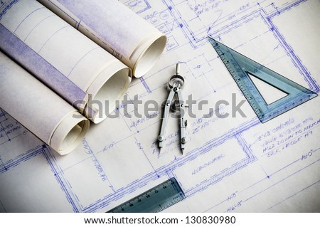 drafting compass and rulers with blueprints - stock photo