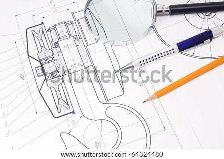 drafting of crane hook with pencil, pen and magnifier - stock photo