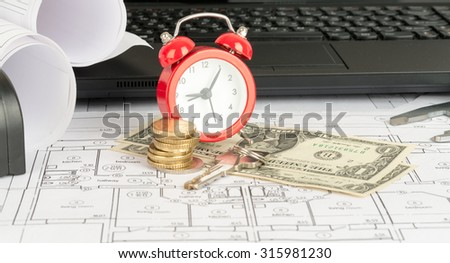 Drafts with black laptop, dollars and alarm clock - stock photo