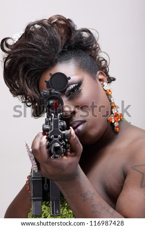 Drag queen aiming an assault rifle. - stock photo