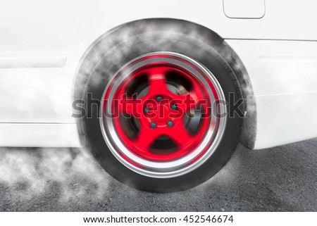 drag racing car from side tire burnout in preparation for the race