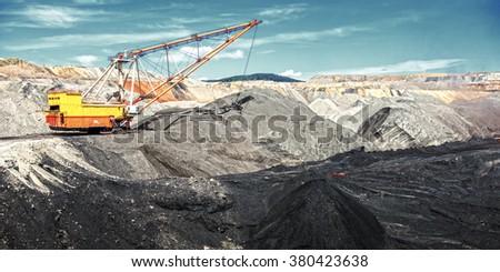 Dragline on open pit coal mine - stock photo