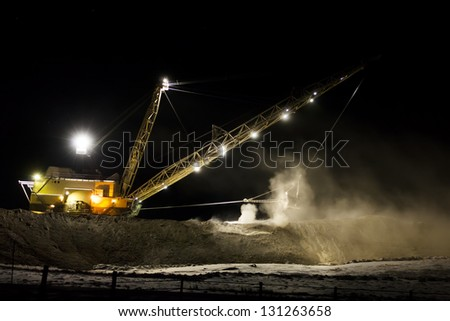 Dragline was found digging at night in Wyoming.  Used for coal mining.  Bucket is massive. - stock photo