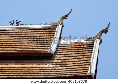 Dragon apex on the roof of Wat Xiang Thong temple in Luang Prabang, Laos - stock photo