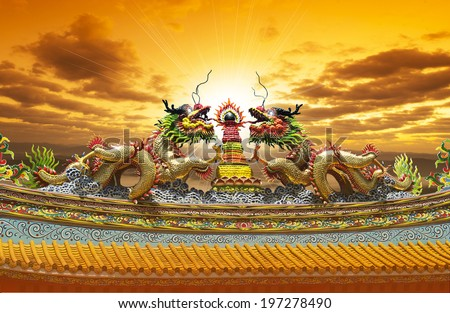 dragon at Chinese Temple Roof - stock photo